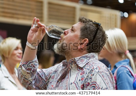 KIEV, UKRAINE - JUNE 04, 2016: Unrecognized man visitor taste wine at Kyiv Wine Festival organized by Good Wine company in Parkovy Exhibition Center.
