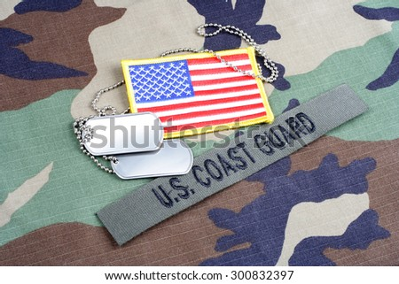 KIEV, UKRAINE - June 6, 2015. US COAST GUARD branch tape, flag patch and dog tags on woodland camouflage uniform