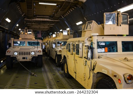 KIEV, UKRAINE - Mar. 25, 2015: US armored vehicles HMMWV (Humvee) on board the aircraft of the US Air Forces at the international airport Boryspil in Kiev - stock photo