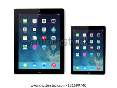 Kiev, Ukraine- March 10, 2014:Apple iPad and iPad Mini displaying iOS 7.1 homescreen. iOS7.1 operating system designed by Apple Inc. official output 10March2014. iPad is a tablet produced by Apple Inc - stock photo