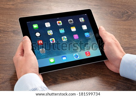 Kiev, Ukraine- March 10, 2014: Apple iPad displaying iOS 7.1 homescreen. iOS 7.1 operating system designed by Apple Inc. official output 10 March 2014. iPad is a tablet produced by Apple Inc. - stock photo