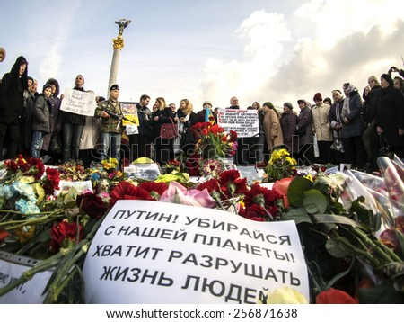 "KIEV, UKRAINE - MARCH1, 2015: At rally in memory of Boris Nemtsov speaks Russian  activist Elena Vasileva. Inscription on banner ""Putin, go away from our planet! Enough to destroy people's lives""  - stock photo"