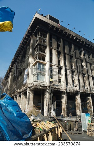 KIEV, UKRAINE - MARCH 13, 2014. Burned Trade Union building on Maidan Nezalezhnosti (Independence Square). It was one of the bases of protesters during anti-government protest on winter 2013-2014. - stock photo