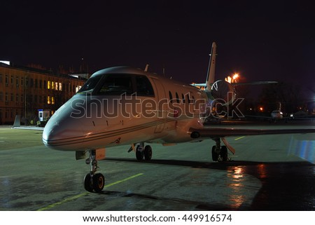 Kiev, Ukraine - March 27, 2011: Business jet parked on the apron at night