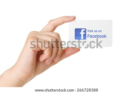 KIEV, UKRAINE - MARCH 31, 2015: Facebook logo printed on paper and placed on white business card. Social network facebook sign on pc sign. - stock photo