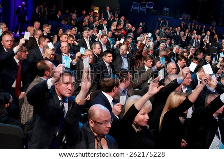KIEV, UKRAINE - March 29, 2014: General view of the hall at the Congress prohibited the Party of Regions of Ukraine. Voting for the election. Last exit before the prohibition and dissolution