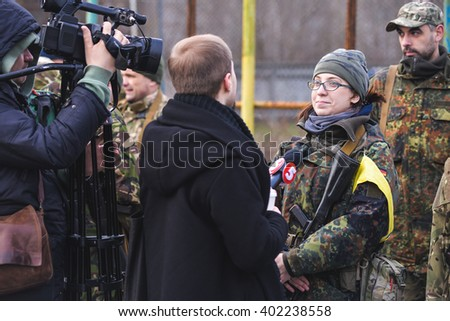 "KIEV,UKRAINE - March 26 : Girl in uniform giving an interview to Ukrainian TV channel during military training for civilians ""RUH 100.Tryzub"" in Kiev,Ukraine on March 26,2016."