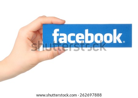KIEV, UKRAINE - MARCH 7, 2015: Hand holds facebook logo printed on paper on white background. Facebook is a well-known social networking service. - stock photo