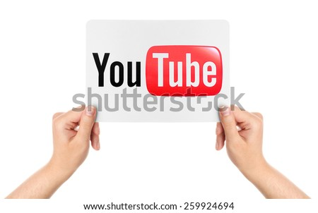 KIEV, UKRAINE - MARCH 08, 2015: Hands hold the paper with YouTube logotype printed on paper. YouTube is a video-sharing website headquartered in San Bruno, California. - stock photo