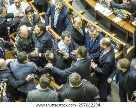 "KIEV, UKRAINE - March 3, 2015: In the hall of the Verkhovna Rada was a fight between leader of faction Radical Party Oleg Lyashko and former member, former battalion commander ""Aydar"" Sergei Melnychuk - stock photo"