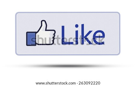 KIEV, UKRAINE - MARCH 15, 2015: Like us on Facebook icon  printed on paper and placed on white background. Facebook is a  one of the largest social networks in the world. - stock photo