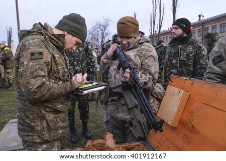 "KIEV,UKRAINE - March 26 : One of the participants of military exercises ""RUH 100.Tryzub"" for civilians received weapons in Kiev,Ukraine on March 26,2016."