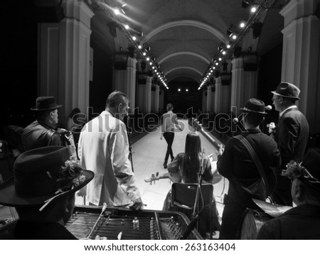 KIEV, UKRAINE - MARCH 18, 2015: Orchestra Rehearsal and models backstage during Ukrainian Fashion Week - stock photo