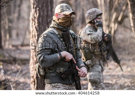 "KIEV,UKRAINE - March 26 : Soldiers at the post-two volunteers in camouflage uniform during military training in forest ""RUH 100.Tryzub"" for civilians in Kiev,Ukraine on March 26,2016."