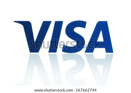 KIEV, UKRAINE - MARCH 21, 2015: Visa logo printed on paper and placed on white background. Visa is an American multinational financial services corporation. - stock photo