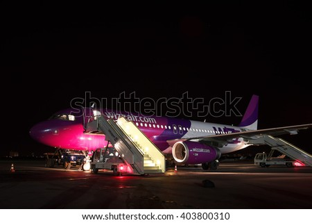 Kiev, Ukraine - March 27, 2011: Wizz Air Airbus A320 passenger plane parked on the apron at the airport at night