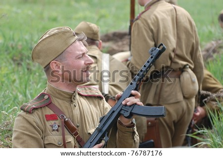 KIEV, UKRAINE - MAY 8 : A member of Red Star history club wear historical Soviet uniform during historical reenactment of WWII on May 8, 2011 in Kiev, Ukraine