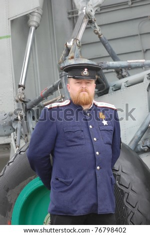 KIEV, UKRAINE - MAY 6 : A member of Red Star history club wears historical Soviet Naval uniform during historical reenactment of WWII, May 6, 2011 in Kiev, Ukraine - stock photo