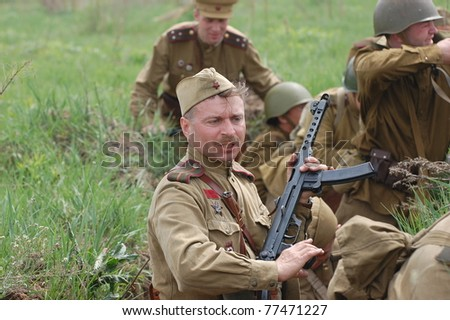 KIEV, UKRAINE - MAY 8 : A member of Red Star history club wears historical Soviet uniform during historical reenactment of WWII on May 8, 2011 in Kiev, Ukraine - stock photo