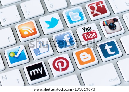 KIEV, UKRAINE - MAY 20, 2013: A social media logotype collection of well-known social network brand's printed on stickers and placed on modern computer keyboard. - stock photo