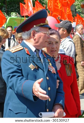 KIEV, UKRAINE - MAY 9: A war veteran at ceremonial parade at Kiev main street - Khreshchatyc - dedicated to the 64th Anniversary of victory in Great Patriotic War (World War II) May 9, 2009 in Kiev.