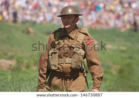 KIEV, UKRAINE - MAY 11 : An unidentified member of Red Star history club wears historical British uniform during historical reenactment of WWII on May 11, 2013 in Kiev, Ukraine