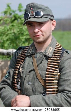 KIEV, UKRAINE - MAY 8 : An unidentified member of Red Star history club wears historical German uniform during historical reenactment of WWII on May 8, 2011 in Kiev, Ukraine