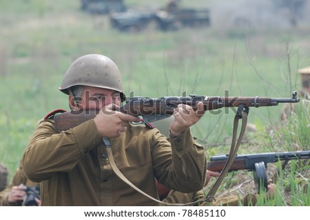 KIEV, UKRAINE - MAY 8 : An unidentified member of Red Star history club wears historical Soviet uniform during historical reenactment of WWII on May 8, 2011 in Kiev, Ukraine