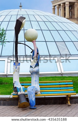 KIEV, UKRAINE - MAY 16, 2016: Artificial lanterns on the bench symbolizing a couple at Independence Square in Kiev, Ukraine - stock photo