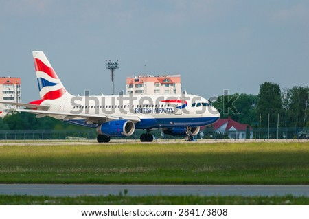 KIEV, UKRAINE - MAY 20, 2015: British Airways Airbus A319-131 acceleration and take-off from Borispol International Airport on May  20, 2015. British Airways is one of the bigest airlines in Europe - stock photo