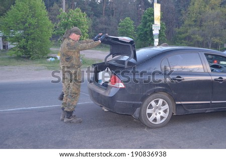 KIEV, UKRAINE - MAY 1, 2014 Checking the transport in the road to Kiev Checkpoint of paramilitary rioters Riot in Kiev and Western Ukraine  - stock photo