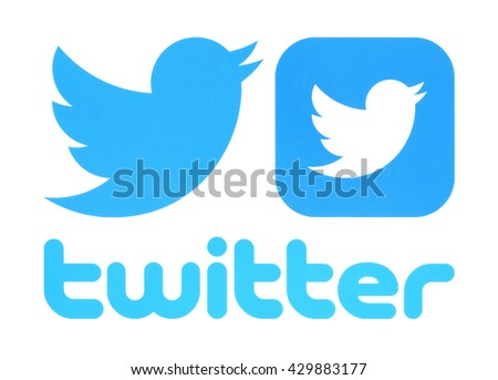 Kiev, Ukraine - May 30, 2016: Collection of Twitter logos printed on paper. Twitter is an online social networking service that enables users to send and read short messages.