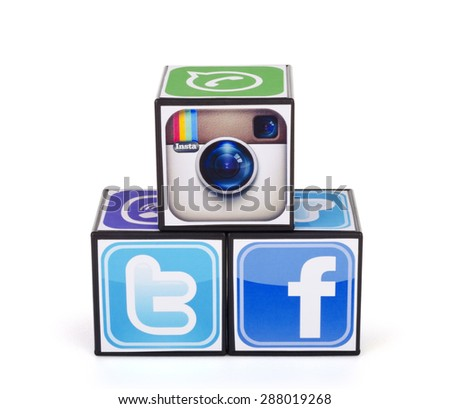KIEV, UKRAINE - MAY 24, 2015: Cubes with logotypes of social media: Facebook, Twitter, Instagram, on a white background. - stock photo