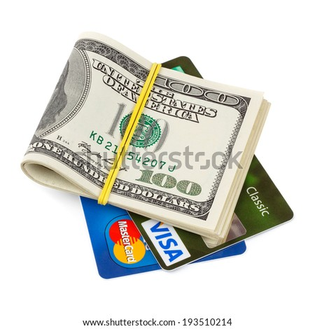 KIEV, UKRAINE - May 18: Dollar bills folded and tied, with credit cards Visa and MasterCard, in Kiev, Ukraine, on May 18, 2014. - stock photo