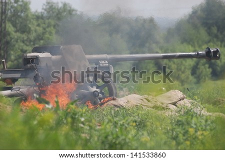 KIEV, UKRAINE - MAY 11 :German WWII cannon.(Red Star military history club in Kiev.)during historical reenactment of WWII on May 11, 2013 in Kiev, Ukraine - stock photo