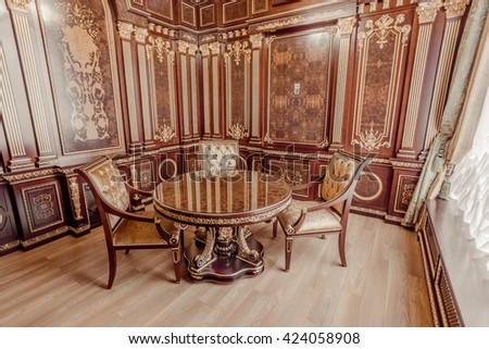 KIEV, UKRAINE - MAY 19, 2016: Interior photosession of the new demo conference room from Ukrainian furniture production. Rich style in wooden and gold textures from - Altair co.