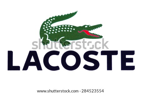 KIEV, UKRAINE - MAY 13, 2015: Lacoste logotype printed on paper and placed on white background. Lacoste  a french company for the production of clothing, shoes, perfumes, leather goods.