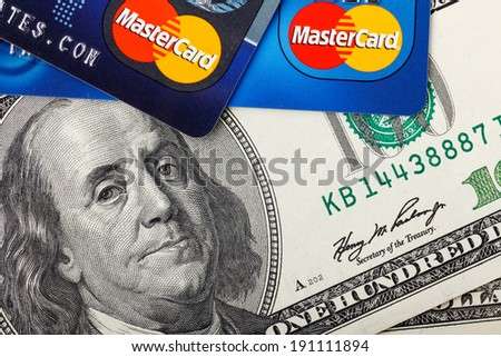 KIEV, UKRAINE - May 5: MasterCard credit cards with US dollar bills, in Kiev, Ukraine, on May 5, 2014. - stock photo