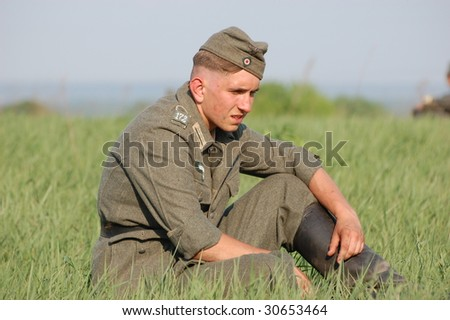 KIEV, UKRAINE - MAY 9: Member of a military history club wears historical German uniform as he participates in a WWII reenactment May 9, 2009 in Kiev, Ukraine.