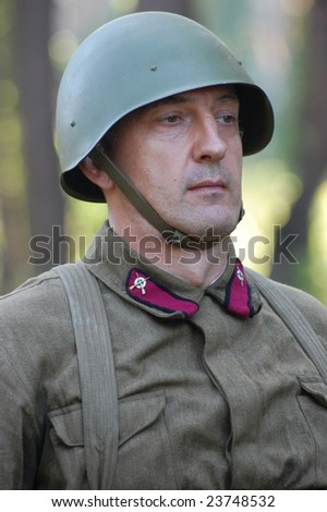 KIEV, UKRAINE - MAY 22: Member of military history club Red Star. Person in Soviet WW2 military uniform. Historical military reenacting in Kiev, Ukraine, 22 May, 2008.