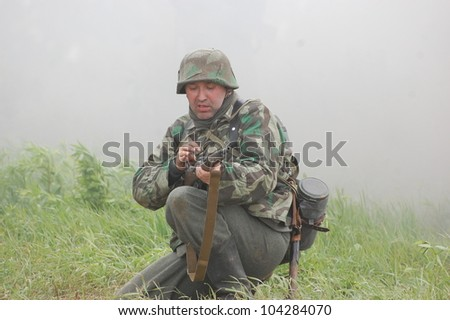 KIEV, UKRAINE -MAY 13: Member of Red Star history club wears historical German uniform during historical reenactment of WWII, May 13, 2012 in Kiev, Ukraine
