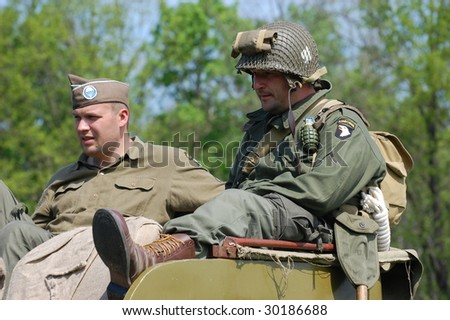 KIEV, UKRAINE - MAY 9: Members of a military history club Red Star wear historical American uniform as they participate in a WWII reenactment May 9, 2009 in Kiev, Ukraine.