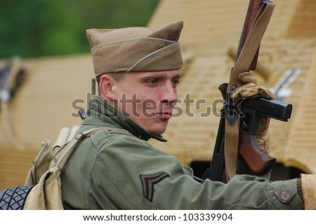 KIEV, UKRAINE -MAY 13: Members of Red Star history club wear historical American uniforms during historical reenactment of WWII, May 13, 2012 in Kiev, Ukraine