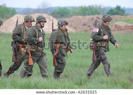 KIEV, UKRAINE - MAY 10: Members of Red Star history club wear historical American uniforms during participation in 1945 WWII reenactment May 10, 2010 in Kiev, Ukraine
