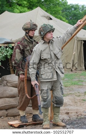 KIEV, UKRAINE -MAY 13:Members of Red Star history club wear historical British  and American uniforms during participation in 1945 WWII reenactment , May 13, 2012 in Kiev, Ukraine