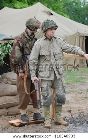 KIEV, UKRAINE -MAY 13: Members of Red Star history club wear historical British and American uniforms during historical reenactment of WWII, May 13, 2012 in Kiev, Ukraine