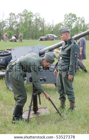 KIEV, UKRAINE - MAY 10 : members of Red Star history club wear historical German uniform during historical reenactment of 1945 WWII, May 10, 2010 in Kiev, Ukraine