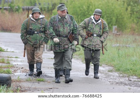 KIEV, UKRAINE - MAY 6 : Members of Red Star history club wear historical German uniform during historical reenactment of  WWII, May 6, 2011 in Kiev, Ukraine
