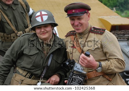 KIEV, UKRAINE -MAY 13: Members of Red Star history club wear historical Soviet and American uniforms during historical reenactment of WWII, May 13, 2012 in Kiev, Ukraine