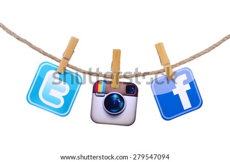 KIEV, UKRAINE - MAY 19, 2015: Popular social media Facebook, Twitter,instagram hanging on the clothesline isolated on white background. - stock photo